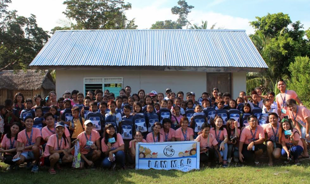 I am M.A.D. (Making A Difference) conquered the town of Magdiwang, Sibuyan Island, Romblon for its 32nd MAD Camp area at Tomas and Maria Maglaya Memorial School. Millenial volunteers together with the beneficiaries and their parents pose for a souvenir photo.